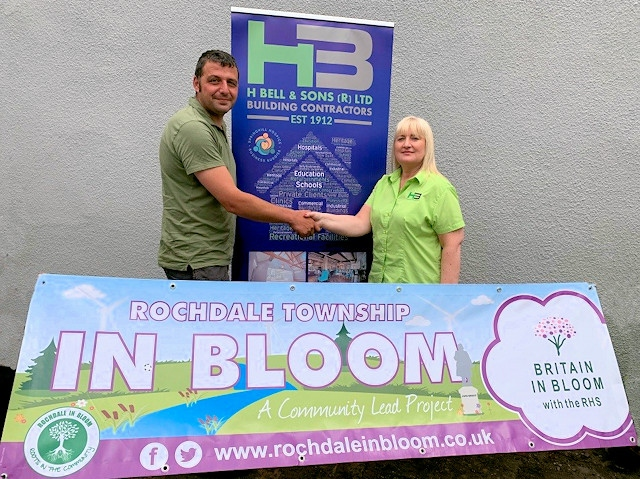 Rochdale in Bloom vice chair, Paul Ellison, with Louise Scott, of H Bell & Sons