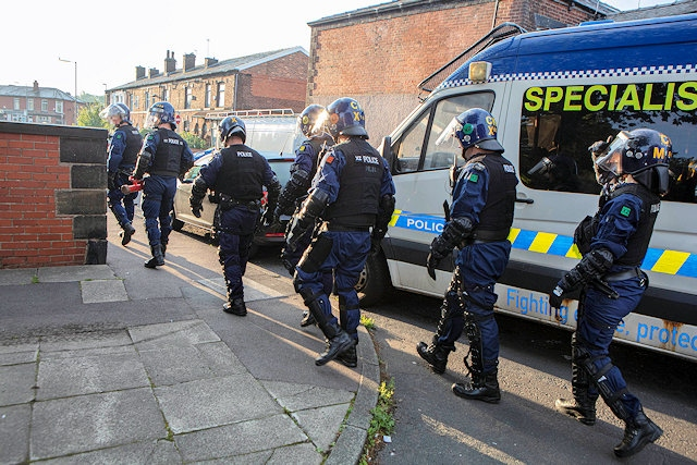 Team of officers executing warrants at properties across Heywood and Bury