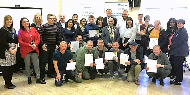 Residents with their certificates following the training programme run Keepmoat Homes and Riverside with former Mayor Mohammed Zaman