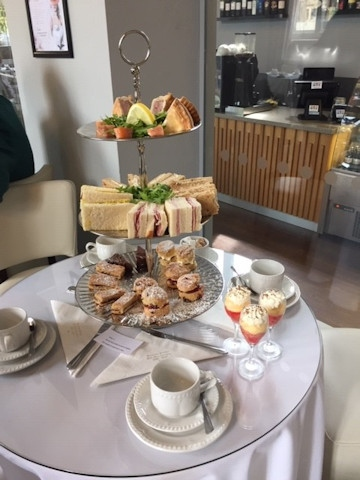 Afternoon tea of sandwiches, scones and individual trifles