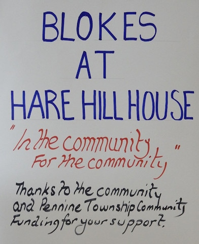Blokes at Hare Hill House sign thanking all for supporting the group