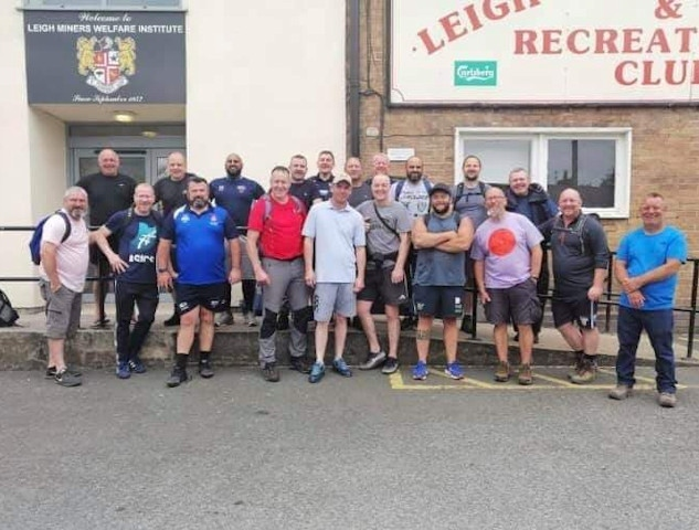 21 rugby friends walked from Mayfield to Leigh Miners (pictured here at Leigh)