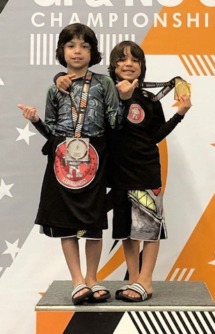 Andrew (left) and Collin Perez (right) with their medals at the BJJ Junior World Championships
