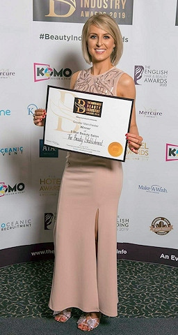 Lucy Atherton, owner of The Beauty Establishment, celebrating her Greater Manchester Five Star Beauty Salon of the Year Award win