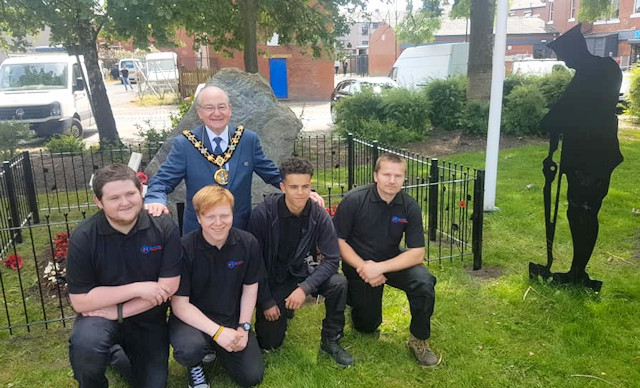 The apprentices and Mayor Billy Sheerin in front of the Memorial