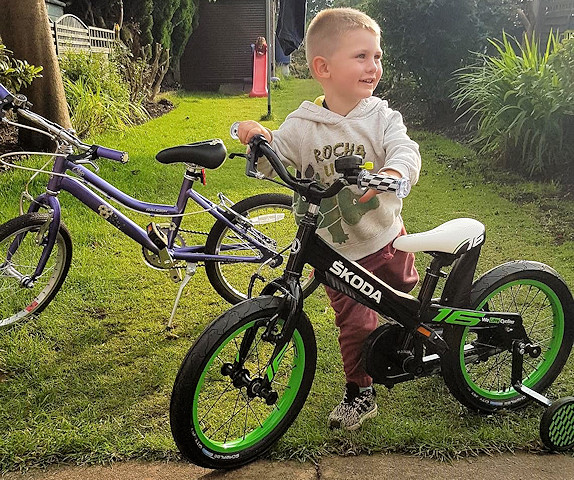 Emmett with his special surprise bicycle from Škoda
