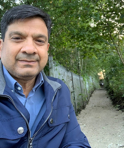 Councillor Faisal Rana with the repaired path