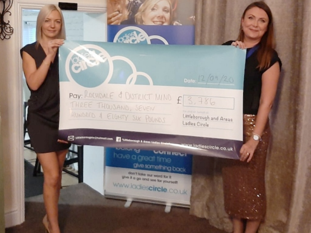 Heidi Murphy hands over the cheque to Rebecca Steele, Rochdale & District Mind CEO (Including Bury & N.E. Lancs)