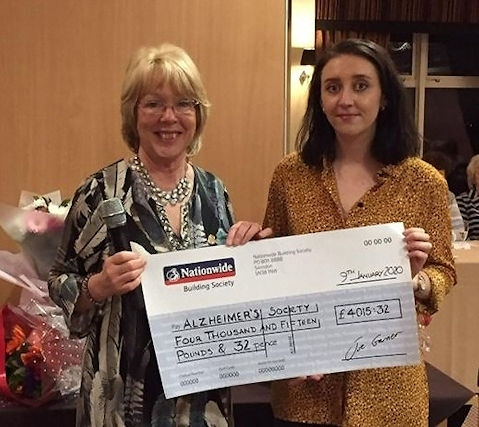 Janice Leonard, Lady Captain of Rochdale Golf Club, presenting a cheque to Danielle Freeman of The Alzheimer's Society