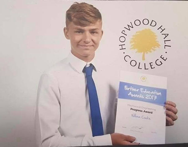 William Cooke with his further education award