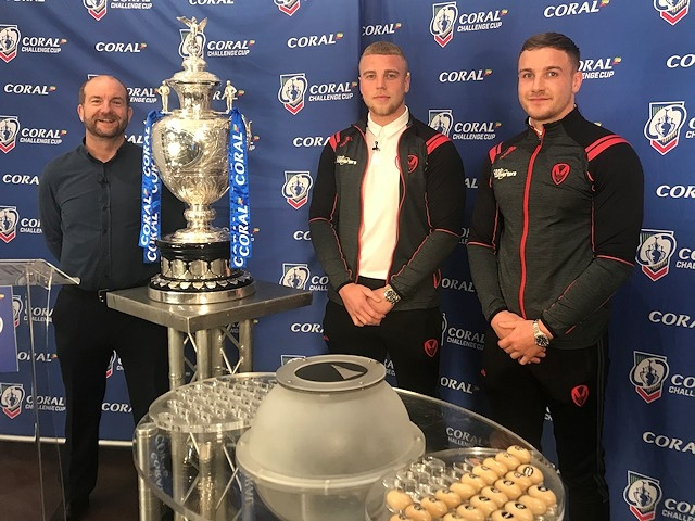 Former Mayfield players Jack Ashworth and Matty Lees did the draw at the Crown Oil Arena (pictured with Dave Woods, BBC Rugby League Correspondent, left)