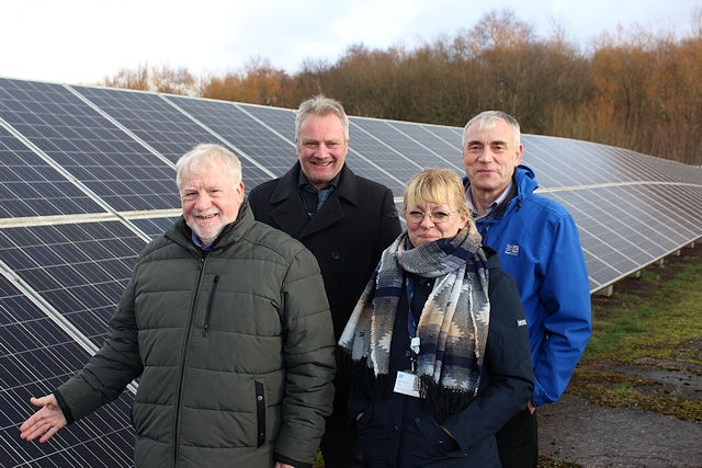 Pictured at the council's solar farm in Rochdale: Councillor Allen Brett, leader of the council; Gary Pilkington, technical building surveying manager; Sam Barker, energy technical support officer; Dave Hughes, senior electrical engineer