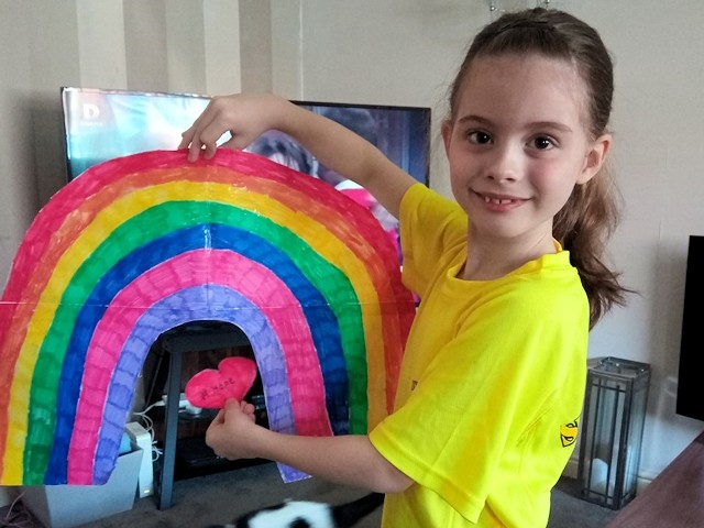 Lily-Rose Davies with the rainbow she drew to display at North Manchester General Hospital