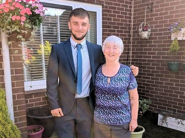 Linda Phillips with grandson Brody before his school prom in 2018