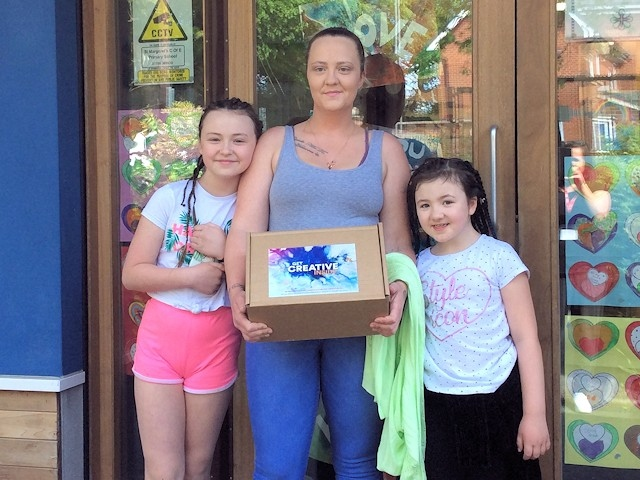 A family from St Margaret's CE Primary School in Heywood with their box