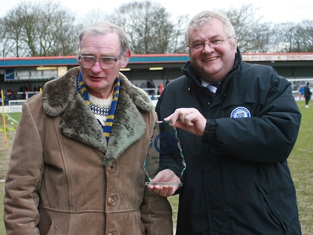 David Clough being presented with his superfan trophy by chairman Chris Dunphy in 2008