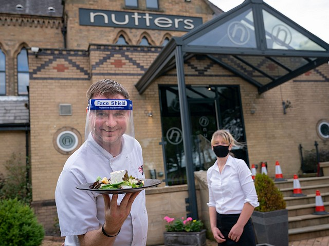 Andrew Nutter with sommelier Helen Whittaker at Nutters Restaurant in Norden which has reopened with new safety measures in place and an improved layout to help with social distancing.