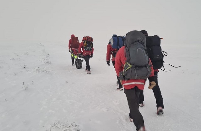 Walkers from Middleton were rescued by the Glossop Mountain Rescue Team after they became lost looking for an aircraft crash site in Derbyshire