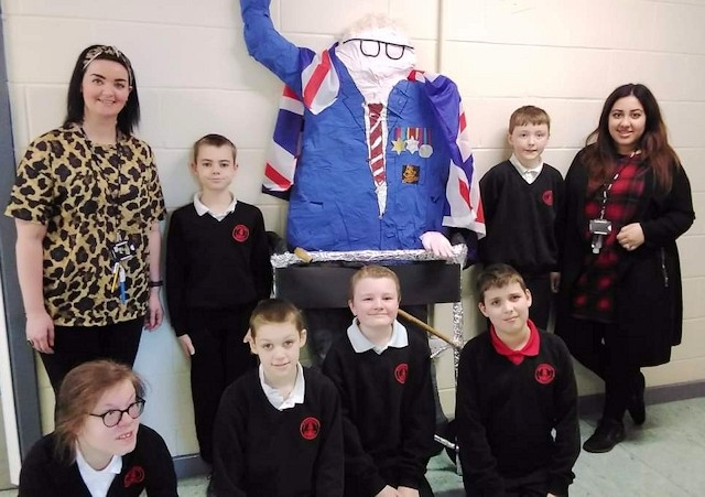 Year 7 pupils and teachers at Redwood School with their statue of Captain Sir Tom Moore
