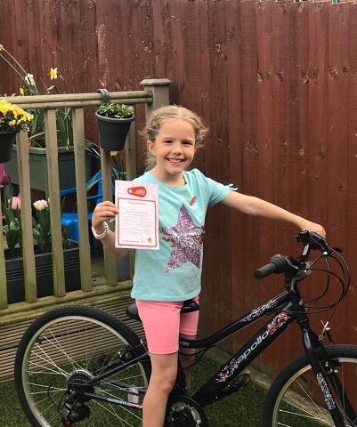 Mia Coley shows off her level one Bikeability certificate
