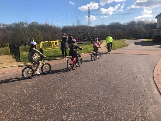 Children on the level one Bikeability course