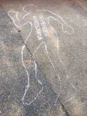 The blasts left behind imprints of people and objects in the path of radiation, leaving behind 'permanent shadows' - commemorated by the group with a white chalk outline of a person