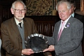 Norman Wellens, Man of Rochdale 2012, presents John Whyman with his Man of Rochdale 2013 award