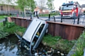 The car demolished the barriers and nosed dived into the canal