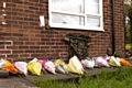 Floral tributes left in the garden of the Rigby family's home on the Langley estate