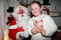 Abigail Schofield meets Father Christmas at Milnrow Parish Church Christmas Fair