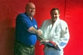 Dave Duffy presented with red and white sixth Dan belt