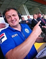 Rochdale AFC's Stuart Ashworth points to Sir Alex Ferguson sat watching in the Spotland stand