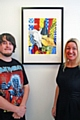 Christopher McHale with his art and Joanne Hill from Forster Dean