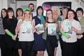 Staff from AST Hampsons wear green for Barnardo's