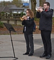 Mr Turner and Y11 student Elisa Iannidinardi in playing The Last Post whilst the school observed a minute silence