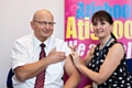 Chairman John Schofield with immuniser Laura Birch