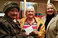 Councillor Carol Wardle and Beverley Place hand over a cheque for �1,500 to Christine Downham-Clark of Heywood Foodbank