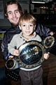 Four-year-old Isaac Journeaux with Martin Stapleton and his world title belt