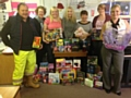 P N Daly collect Christmas gifts