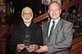 Rochdale Council of Mosques annual dinner<br />Mohammed Iqbal with Simon-Danczuk after collecting his award for voluntary services to the bereaved