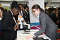 Student speaks to a Source BioScience representative about careers in science a the Rochdale Skills Event