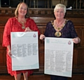 Pride of Rochdale initiative<br />Mayoress Beverley Place and Mayor Carol Wardle with the scroll signed local businesses and organisations