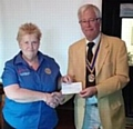 Club President Len Albon presenting the donation to Pam Joyce of Disaster Aid UK & Ireland
