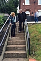 Elderly residents attempting to use the steep steps on Major Street, Milnrow
