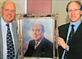 Graham and Nigel Adamson with a painting of Ronald Adamson