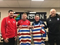 Analyst Steve Wordsworth, first team players Chris Riley and Jono Smith and head coach Alan Kilshaw show off the Ensign logo on the 2017 home shirt
