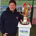 Kate Bennetta, Littleborough Rugby Club's youth director, with the U20s world cup trophy