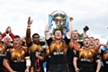Rochdale Hornets celebrate a magnificent victory over Toulouse Olympique in the League One Promotion Final at Stade Ernest-Argel�s in Blagnac, France