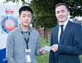 Changyu Yang, a GMP apprentice, with Councillor Sean Anstee