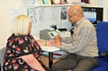 Dr Gupta from Pennine Surgery, Littleborough with patient having a fingerprick blood test to tell whether she needs antibiotics to treat her symptoms